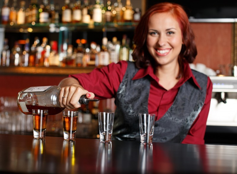 BASSET certified bartender serving a beer with Serving Alcohol training
