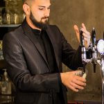 Bartender serving beer from tap with alcohol training