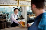 Bartender serving a beer with Serving Alcohol training