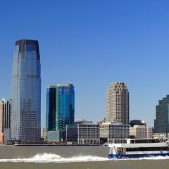 ferry and New Jersey skyline during the day