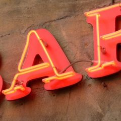 red and yellow neon bar sign