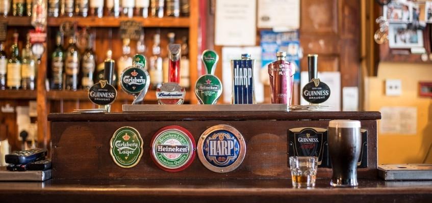 beer taps at wooden countertop bar